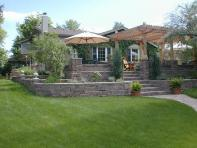 image of hardscape landscaping with pavers, stone driveway, stone wall construction